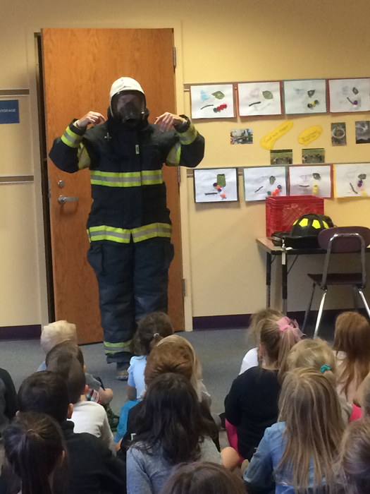 Fireman works with students.