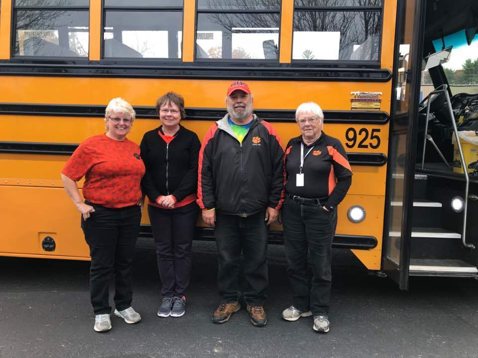 Debbie, Diane, Ted & Barbara in front of school bus