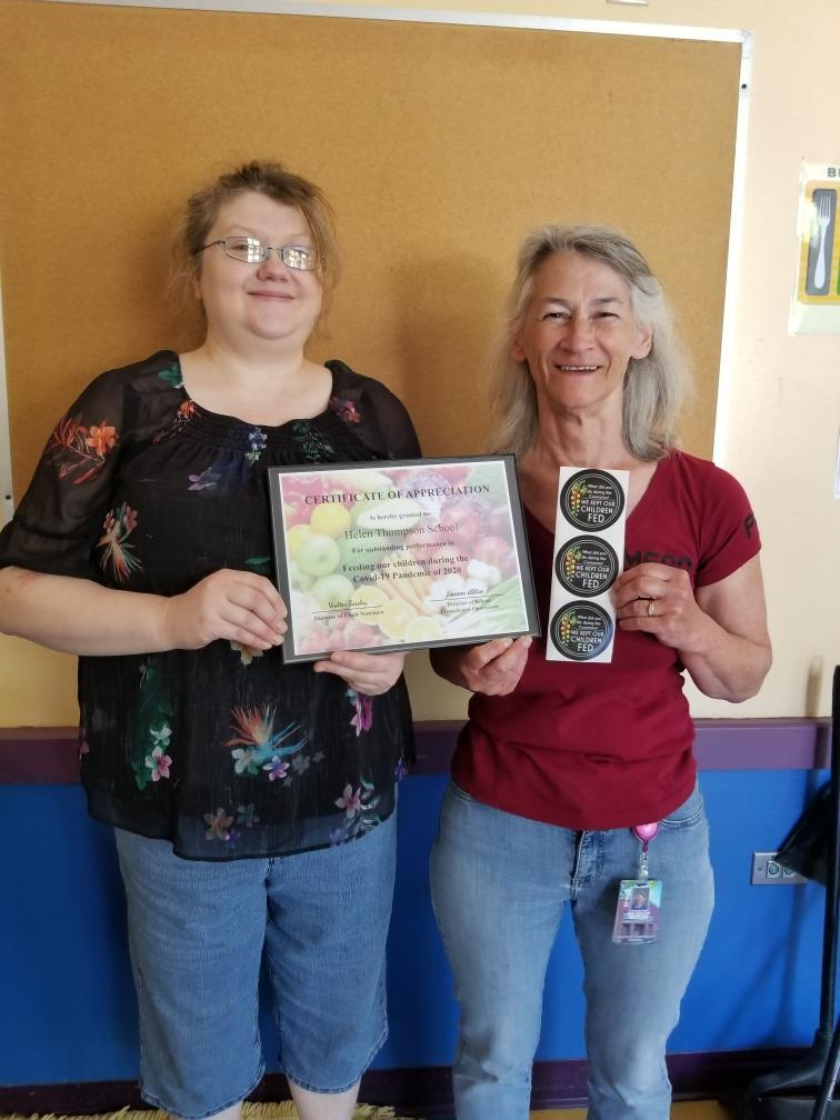 Photo of Mrs. Butler & Mrs. Shaw with award